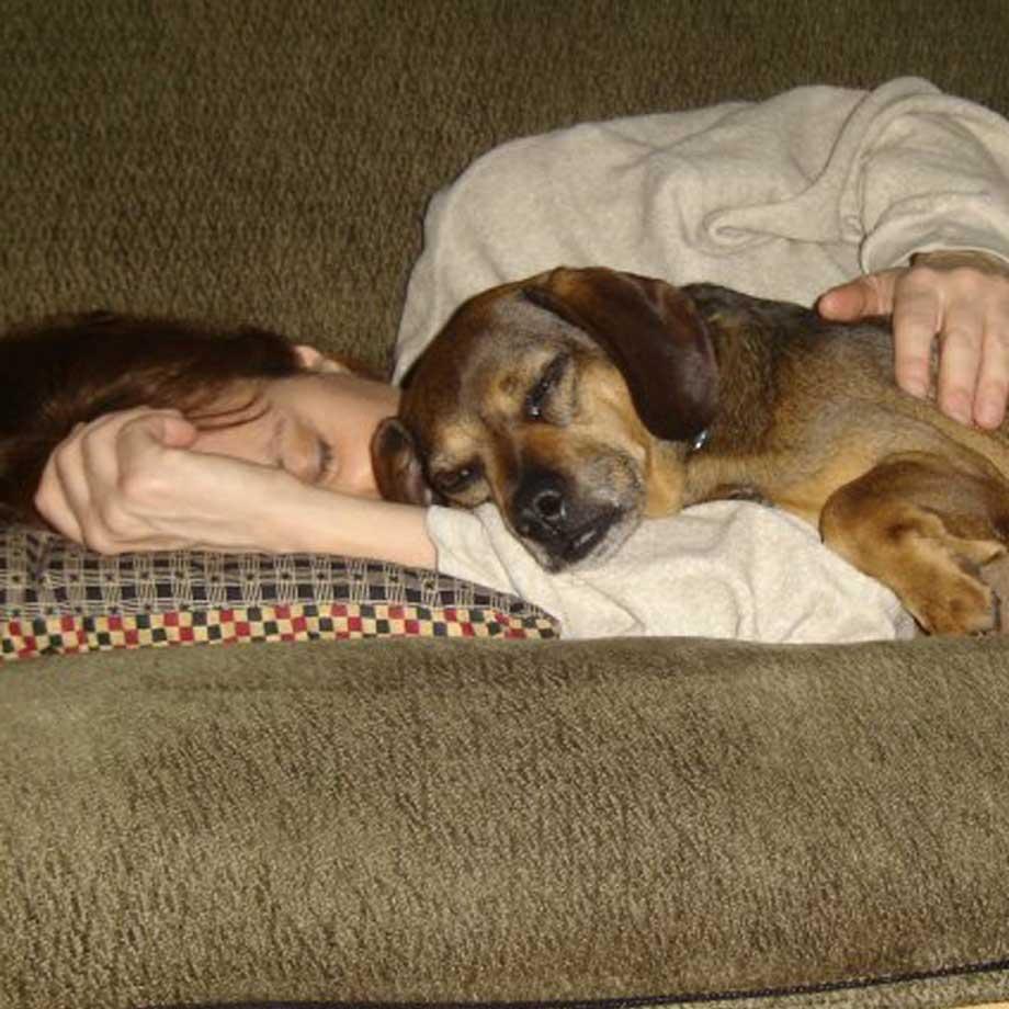 Heidi Mastrogiovanni, napping with dog